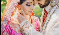 wedding couple poses for photoshoot